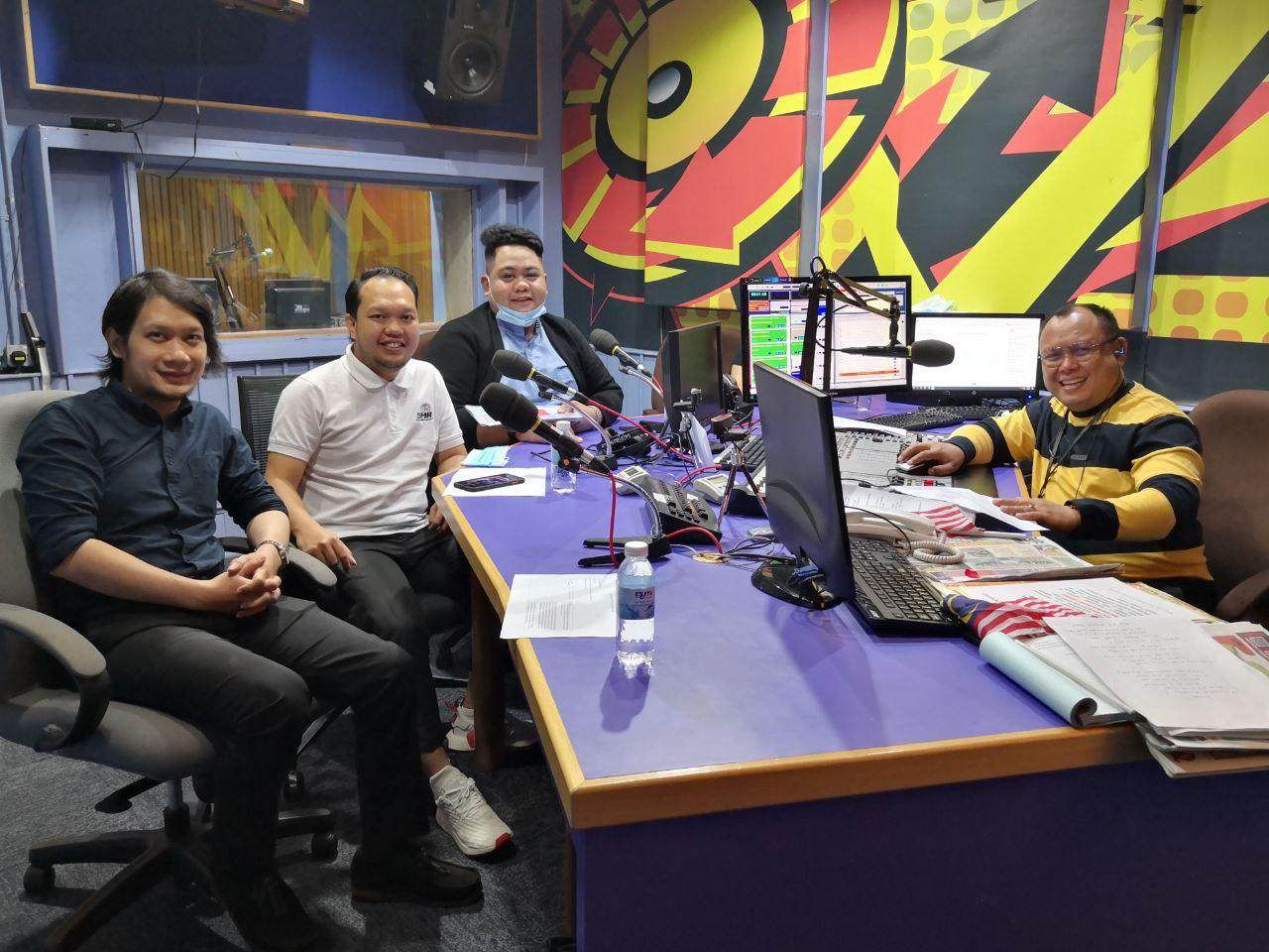 (from left) SMA assistant officer Hafeez Rosland, Faizal, AZAM communication officer Hakim Junaidi and Sarawak FM broadcaster Azman Johari pose for a photo call after the radio interview.